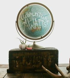 This vintage globe with hand-lettered designs reminds you that adventure awaits.