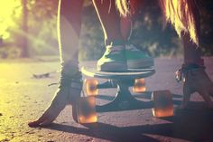 Skate beach snow surf board wheels vans green sidewalk sunset