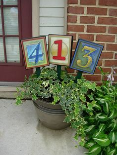 Put your house numbers in a potted plant at your front door Look for this on my front porch stoop this season :)