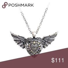 NEW ARRIVAL ANGEL HEART WINGS W/CRYSTAL DETAIL NEW ARRIVAL ANGEL HEART WINGS W/CRYSTAL DETAIL                                                                                      3 IN EXTENDER - Materials: Metal - Length: 22 inch - Weight: 1.0 oz -Lead & Nickel Free Dina Aziza Jewelry Necklaces