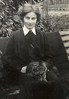 Dora posing with Fluff in 1913. The photograph was taken by A C Crocker of Yeovil