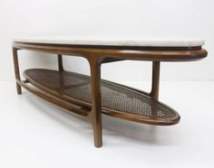 Mid-Century Modern Marble and Walnut Coffee Table by Lane. Beautiful oval surfboard shape and lower cane shelf. Perfect cocktail table, pair it with