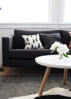 ikea karlstad in dark gray with updated legs and coffee table. Someone stole my stuff.