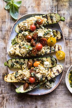 A healthy vegetarian recipe of tomato, feta, and orzo stuffed inside a grilled pesto zucchini. This quick and easy dish is perfect for spring and summer days and doubles as a healthy dinner or simple side dish. Either way you ser Grilling Recipes, Cooking Recipes, Cooking Steak, Cooking Turkey, Half Baked Harvest, Side Dishes Easy, Summer Recipes, Food To Make, Vegan Recipes
