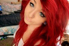 Nose piercing; red hair; gauges