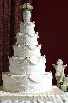 Rex Wants A No Holds Barred Traditional Wedding Cake White Victorian Style Five Tier Decorted With Clic Scrolls