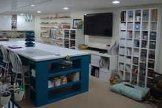Great craft room inspiration. I think my garage needs a make-over.