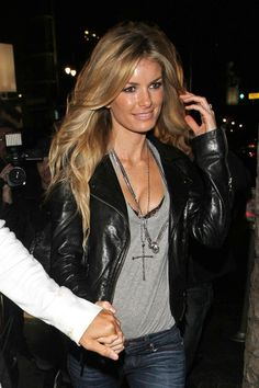 simple tee, leather jacket, long necklace and it wouldn't hurt to look like marissa miller :)