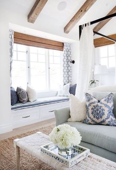 Wood beams on ceiling   Beautiful blue and white living room scheme. Could be country or coastal. If you like this pin, why not head on over to get similar inspiration and join our FREE home design resource library at www.FlorenceAndFreya.com?