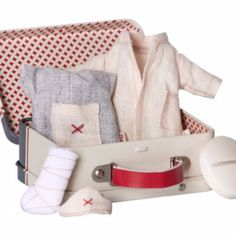 Maileg First Aid Suitcase Micro Nurse & Dr Outfits Toy Set: This wonderful suitcase from Maileg contains everything that a your micro mouse/ bunnies will need; a nurse dress and head scarf, a doctors coat, a leg plaster cast for the patient and a rather large tablet.