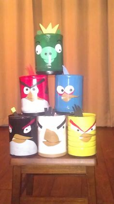 Angry Bird Game bean bag toss. My mom took empty cans and painted faces of angry birds and pig. She made three bean bags out of scraps. My son loves this game. So much fun for all ages.