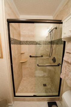 Bathroom Remodel brought to you by Re-Bath of the Triangle, Glass, walk-in shower, dual grab bar, corner shelves, tile feature strip, low threshold walk in shower, perfect for Universal Design bathrooms, Aging in Place Showers,
