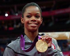 Team USA's Gabrielle Douglas smiles on the podium