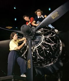 October 1942. Engine installers at Douglas Aircraft in Long Beach, California. 4×5 Kodachrome transparency by Alfred Palmer.