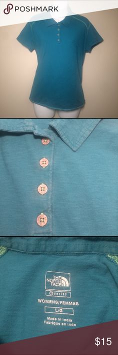 """The North Face Polo This polo shirt by The North Face is in good condition with some minimal signs of wear. The shorty is a turquoise with a light green stitching and shell buttons. This is a size Large and measures approximately 17"""" from shoulder to shoulder and 23""""from shoulder to bottom hem. The North Face Tops"""