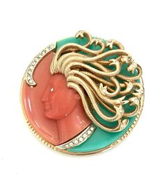 Kramer (Unsigned) Medusa Brooch  A stunning brooch that is a part of Kramers much sought after Mythology Collection  In Greek mythology Medusa was a female creature that had the power to turn to stone whoever should gaze upon her. Her story is timeless and has been handed down through centuries. This intriguing myth has been artistically captured in this pin by the design firm Kramer. This pretty brooch is extremely hard to find and does not often come on the market. It is both a beautiful…
