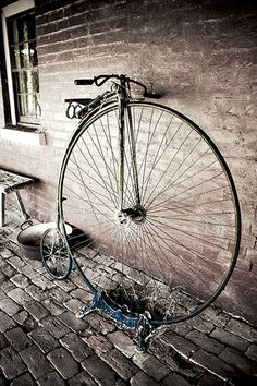 Another penny farthing leaning against a brick wall, but isn't it beautiful?