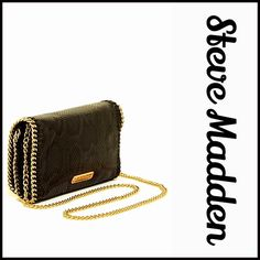 """STEVE MADDEN Black Chain Crossbody Clutch Bag STEVE MADDEN Black Chain Mini Crossbody Clutch Bag NEW WITH TAGS    * Allover textured vegan like leather exterior w/gold-tone chain edge trim  * Crossbody or carry as a clutch  * Foldover flap w/magnetic closure & an interior wall slip pocket  * Approx. 5.5"""" H x 8.75"""" W x 1.25"""" D  * Approx. 23.5"""" strap drop.    Material: PU exterior & polyester lining Color: Black   No Trades ✅ Offers Considered*/Bundle Discounts✅ *Please use the 'offer' button…"""
