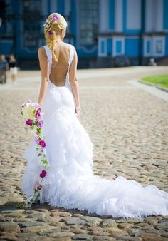 Braid with beautiful flowers and unique wedding dress #hot #sexy #hairstyles #hairstyle #hair #long #short #medium #buns #bun #updo #braids #bang #greek #braided #blond #asian #wedding #style #modern #haircut #bridal #mullet #funky #curly #formal #sedu #bride #beach #celebrity #simple #black #trend #bob #girls