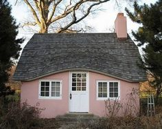 pink cottage with eyebrow roofline, source unknown...I could knit here forever!