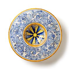 With fluid, elegant designs inspired by the family crests and seals of medieval Florence, the Flora Blu Medium Round Wall Plate is a stunning and striking masterpiece to bring into your home. With its strong, rich glazes and intricate design work, the plate is quintessentially Italian.