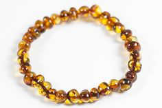 Luxury natural Baltic amber bracelet. Polished healing amber beads.