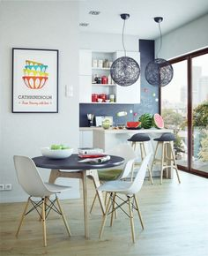 salle à manger scandinave avec lampes boules et tabourets assortis