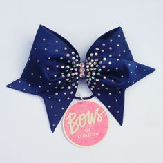 Navy bow with AB crystals and large AB centre crystals. Approx. 25cm from tail to tail.