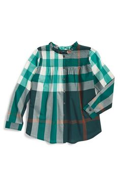 Free shipping and returns on Burberry 'Bretta' Tunic (Little Girls & Big Girls) at Nordstrom.com. A smartly pleated yoke and ruffled collar add irresistible charm to a cotton-woven tunic in a classic check pattern.