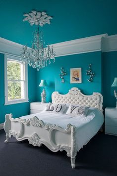 Love the blue and pure white together, the neat bed and the LOVE pillows.