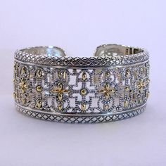 Sterling Silver & 14 Karat Yellow Gold Hinged Cuff Bracelet from our Eleganza Collection at J. Schrecker Jewelry. Visit us at our website or at www.facebook.com/jschreckerjewelry