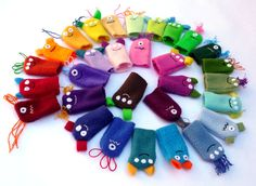 Each monster, alien, or creature finger puppet is handmade in Saint Louis, MO from luscious anti-pill fleece material with hand stitched details. Theyre a perfect toy to encourage creative play and interactive fun! They are hand-crafted in a smoke-free home with all new materials and securely sewn with no buttons or other small parts.  This listing is for individually packaged finger puppets in a variety of color & style combinations. The photos represent a sample of what your finger pupp...