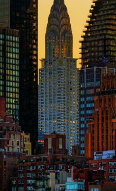 NYC. The Chrysler Building surrounded by a  golden glow at sunrise