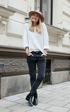 white sweater black jeans boots hat casual street style women fashion