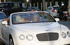 Heidi Klum in a white Bentley Continental GTC. Kobe Bryant, Jennifer Lopez, Tamara Ecclestone and Jennifer Love Hewitt also have a white Bentley Continental GT or GTC