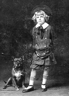 Tige and Richard S. Barker as Buster Brown around 1910. Barker was the first child to portray Buster Brown for the Brown Shoe company. (All the previous actors had been little people.) Barker toured the country with his widowed mother from 1908 to 1914 performing shows as Buster.