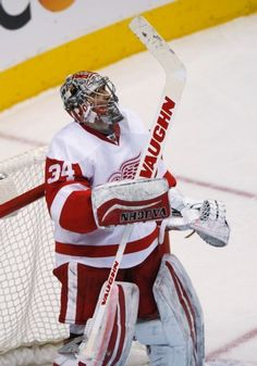 Detroit Red Wings goalie Petr Mrazek, of the Czech Republic, raises his stick as time runs out against the Colorado Avalanche in the third period of an NHL hockey game Thursday, Feb. 5, 2015, in Denver. Detroit won 3-0. (AP Photo/David Zalubowski)
