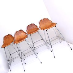 Charlotte Perriand stools, leather and metal.