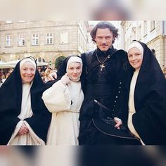 """I would probably do the same if I were an extra of a film! ;-) P.S.-Now where are those """"Brides"""" they're looking for?! They must be part of the Dracula Untold sequel!:-D  Photo: Luke with extras in Bamberg Source: orlandolove.net  #lukeevans #luketeer #luketeers #lukeevansfan #lukeevansfans #aramis #thethreemusketeers #extras"""
