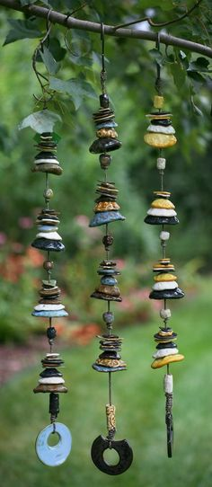 Ceramic Wind Chime Mobile This dramatic strand of individually crafted pottery discs fired in earthy glazes is a very striking piece of art. This unique mobile brings a real artisan's touch to your home when hung by a doorway Hand Built Pottery, Slab Pottery, Ceramic Pottery, Pottery Art, Pottery Ideas, Pottery Studio, Thrown Pottery, Pottery Houses, Ceramic Houses