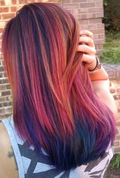 Pravana vivids and locked in create a tropical sunset. Pink, peach, yellow, purple, magenta, teal, and blue hair.