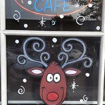 #GoalGraphics spreading holiday cheer with painting xmas owl! #artist #windowpainting #graphicdesign #Rudolph #redNose #christmas #reindeer