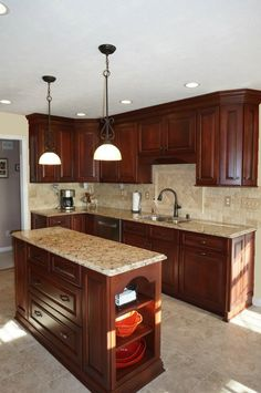Brauch Custom Cabinetry, Cherry Wood with Bourbon Stain. Bubble Bead Door with Raised Panel. 5 Piece Drawer Fronts With Full Extension, Soft Close Guides. Countertops are Cambria Quartz color Bradshaw. - By Angie Torp