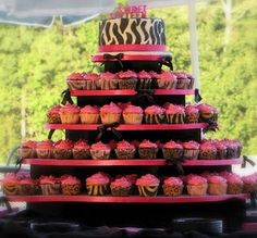 I like the cupcake idea. We could do a cake at the top for each of you, then save it to eat on your actual bday