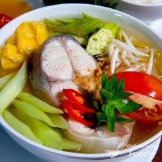 Rich with contrasts, Vietnamese Sour Fish Soup (Canh Chua Ca) is easy to like. The tamarind and pineapple provide a sweet-and-sour edge, while the okra