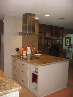 Kitchen remodel after removing load bearing wall and installing a power beam to open up kitchen to the living room.