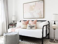 Pink and black guest room features a pink and gold abstract art piece placed ove. - Pink and black guest room features a pink and gold abstract art piece placed over a black daybed dr - Daybed Pillows, Daybed Room, Pink Pillows, Daybed Pillow Arrangement, Black Daybed, Ideas Habitaciones, Metal Daybed, Pink Bedroom For Girls, Bedroom Boys