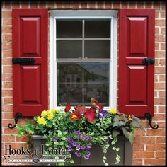 Standard & Custom Exterior Shutters are the perfect way to add instant curb appeal to your home. Don't stop at window boxes, make your home stand out with gorgeous decorative window shutters like these! #CurbAppeal #Design