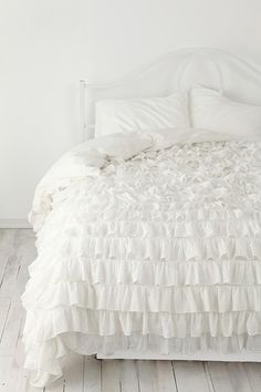 Love all white bedding with ruffles or embroidery so it still isn't plain <3