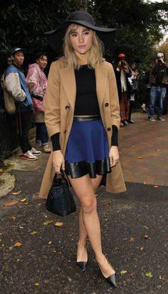 Meet the Celebs Who Have Healthy Topshop Obsessions!: At the Topshop Unique Spring 2014 show in London, Ashley Madekwe styled herself in a Topshop Unique shearling jacket, red Topshop trousers, and black pumps, also by Topshop.  : Ellie Goulding's Topshop miniskirt added a feminine flair to her black leather biker jacket, Topshop crop top, London.  : At the Topshop Unique Spring 2014 show, Suki Waterhouse posed in a navy skirt with…eww on the shoes